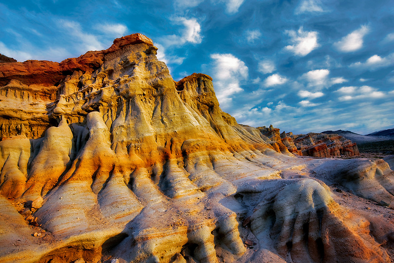 Puffy clouds and colorful sandstone rocks at Red Rock Canyon State Park, California