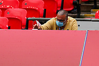 A photographer with a face covering due to the COVID-19 pandemic during the Sky Bet League 2 PLAY-OFF Final match between Exeter City and Northampton Town at Wembley Stadium, London, England on 29 June 2020. Photo by Andy Rowland.