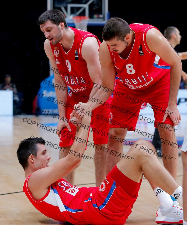 Serbia's Nemanja Bjelica, Stefan Markovic and Zoran Erceg during European championship basketball match for third place between France and Serbia on September 20, 2015 in Lille, France  (credit image & photo: Pedja Milosavljevic / STARSPORT)