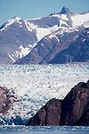 Alaska, Tracy Arm, A Luxury Cruise Ship is dwarfed at the blue-ice face of the Sawyer Glacier, Southeast Alaska, Inside Passage,.