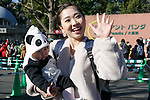 Visitor Hitomi Suwato and her baby dressed as panda, pose for a photograph after meet new giant panda cub Xiang Xiang at Tokyo's Ueno Zoo on December 19, 2017, Tokyo, Japan. The new female panda cub Xiang Xiang, born June 12, 2017, is being shown to the public for the first time. More than one thousand visitors are expected to come to see the panda on the day of her public debut. (Photo by Rodrigo Reyes Marin/AFLO)