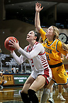 SIOUX FALLS, SD - MARCH 8: Liv Korngable #2 of the South Dakota Coyotes eyes the basket in front of Heaven Hamling #11 of the North Dakota State Bison during the Summit League Basketball Tournament at the Sanford Pentagon in Sioux Falls, SD. (Photo by Dave Eggen/Inertia)
