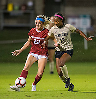 NWA Democrat-Gazette/BEN GOFF @NWABENGOFF<br /> Parker Goins (22), Arkansas forward, passes the ball as Nia Dorsey, Vanderbilt defender, pressures in the first half Thursday, Sept. 26, 2019, at Razorback Field in Fayetteville.