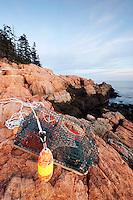 Lobster trap washed up on pink granite rocky shoreline, Mount Desert Island, Acadia National Park, near Bar Harbor, Maine, USA