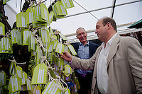 Tuesday 27 May 2014, Hay on Wye, UK<br /> Pictured: ( L-R )   AM John Griffiths and National Trust Director for Wales, Justin Albert stand in front of the National Trust's Memory Tree<br /> Re: The Hay Festival, Hay on Wye, Powys, Wales UK.