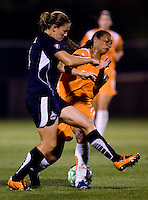 Washington Freedom defender (4) Cat Whitehill fights for the ball with Sky Blue FC midfielder (11) Rosana at the Maryland SoccerPlex in Boyds, Maryland.  The Washington Freedom defeated Sky Blue FC, 3-1, to secure a place in the playoffs.