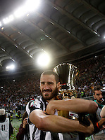Calcio, finale Tim Cup: Juventus vs Lazio. Roma, stadio Olimpico, 20 maggio 2015.<br /> Juventus' Leonardo Bonucci holds the trophy in his arms at the end of the Italian Cup final football match between Juventus and Lazio at Rome's Olympic stadium, 20 May 2015. Juventus won 2-1 after extra time.<br /> UPDATE IMAGES PRESS/Isabella Bonotto