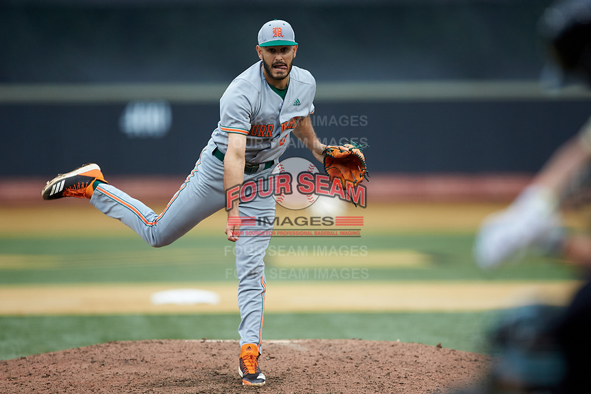 Miami Hurricanes relief pitcher Gregory Veliz (0) in action against the Wake Forest Demon Deacons at David F. Couch Ballpark on May 11, 2019 in  Winston-Salem, North Carolina. The Hurricanes defeated the Demon Deacons 8-4. (Brian Westerholt/Four Seam Images)