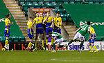 Hibs v St Johnstone…24.11.20   Easter Road      SPFL<br />Stevie Mallan's free kick is blocked by Jamie McCart<br />Picture by Graeme Hart.<br />Copyright Perthshire Picture Agency<br />Tel: 01738 623350  Mobile: 07990 594431