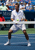 Radek Stepanek hits a volley during the Legg Mason Tennis Classic at the William H.G. FitzGerald Tennis Center in Washington, DC.  Mardy Fish and Mark Knowles defeated Tomas Berdych and Radek Stepanek in the doubles final on Sunday afternoon.