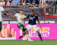 Foxborough, Massachusetts - September 1, 2018: First half action. In a Major League Soccer (MLS) match, New England Revolution (blue/white) vs Portland Timbers (white/green), at Gillette Stadium.