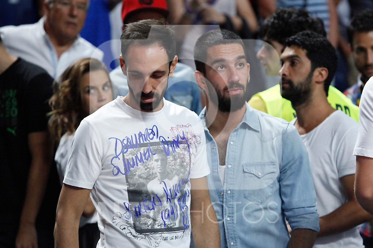 Atletico de Madrid´s Arda Turan (R) and Juanfran during FIBA Basketball World Cup Spain 2014 final match between United States and Serbia at `Palacio de los deportes´ stadium in Madrid, Spain. September 14, 2014. (ALTERPHOTOSVictor Blanco)