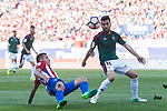 Angel Correa of Atletico de Madrid (L) in action against Juan Rafael Fuentes Hernandez of Osasuna (R) during the La Liga match between Atletico de Madrid vs Osasuna at the Estadio Vicente Calderon on 15 April 2017 in Madrid, Spain. Photo by Diego Gonzalez Souto / Power Sport Images