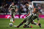 Marco Asensio Willemsen (l) of Real Madrid fights for the ball with Jakub rzezniczak of Legia Warszawa during the 2016-17 UEFA Champions League match between Real Madrid and Legia Warszawa at the Santiago Bernabeu Stadium on 18 October 2016 in Madrid, Spain. Photo by Diego Gonzalez Souto / Power Sport Images