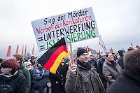 Mehr als 10.000 Anhaengern der rechten Pegida-Dresden versammelten sich am Sonntag den 25. Januar 2015 in Dresden vor der Semper-Oper, unter ihnen etliche militante Hooligans und Neonazis aus dem ganzen Bundesgebiet sowie Rechte, die eigens aus Belgien und Daenemark angereist waren. Hooligans mit Ordnerbinden kooperierten nach Polizeiangaben mit den Beamten und kontrollierten die Presseausweise von Medienvertretern.<br /> Ca. 2.000 Menschen protestierten gegen den Aufmarsch der Rechten.<br /> 25.1.2015, Dresden<br /> Copyright: Christian-Ditsch.de<br /> [Inhaltsveraendernde Manipulation des Fotos nur nach ausdruecklicher Genehmigung des Fotografen. Vereinbarungen ueber Abtretung von Persoenlichkeitsrechten/Model Release der abgebildeten Person/Personen liegen nicht vor. NO MODEL RELEASE! Nur fuer Redaktionelle Zwecke. Don't publish without copyright Christian-Ditsch.de, Veroeffentlichung nur mit Fotografennennung, sowie gegen Honorar, MwSt. und Beleg. Konto: I N G - D i B a, IBAN DE58500105175400192269, BIC INGDDEFFXXX, Kontakt: post@christian-ditsch.de<br /> Bei der Bearbeitung der Dateiinformationen darf die Urheberkennzeichnung in den EXIF- und  IPTC-Daten nicht entfernt werden, diese sind in digitalen Medien nach §95c UrhG rechtlich geschuetzt. Der Urhebervermerk wird gemaess §13 UrhG verlangt.]