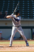 Salt River Rafters third baseman Josh Fuentes (19), of the Colorado Rockies organization, at bat during an Arizona Fall League game against the Mesa Solar Sox at Sloan Park on October 30, 2018 in Mesa, Arizona. Salt River defeated Mesa 14-4 . (Zachary Lucy/Four Seam Images)