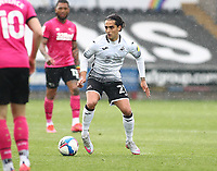 1st May 2021; Liberty Stadium, Swansea, Glamorgan, Wales; English Football League Championship Football, Swansea City versus Derby County; Yan Dhanda of Swansea City looks for a team mate to pass to under pressure