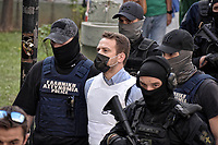 Pictured: Charalambos (Babis) Anagnostopoulos leaves the court building, led by police in Athens, Greece. Tuesday 22 June 2021<br /> Re: Charalambos (Babis) Anagnostopoulos, the husband of Caroline Crouch, who was killed in front of her 11 month old daughter is due to appear before a Magistrate, after being charged with her murder at their home in Glyka Nera, near Athens, Greece.<br /> The woman, 20, was allegedly first tortured and then strangled to death.