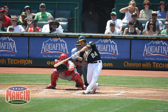 OAKLAND, CA - JULY 13:  Kurt Suzuki of the Oakland Athletics bats during the game against the Los Angeles Angels of Anaheim at the McAfee Coliseum in Oakland, California on July 13, 2008.  The Angels defeated the Athletics 4-3.  Photo by Brad Mangin
