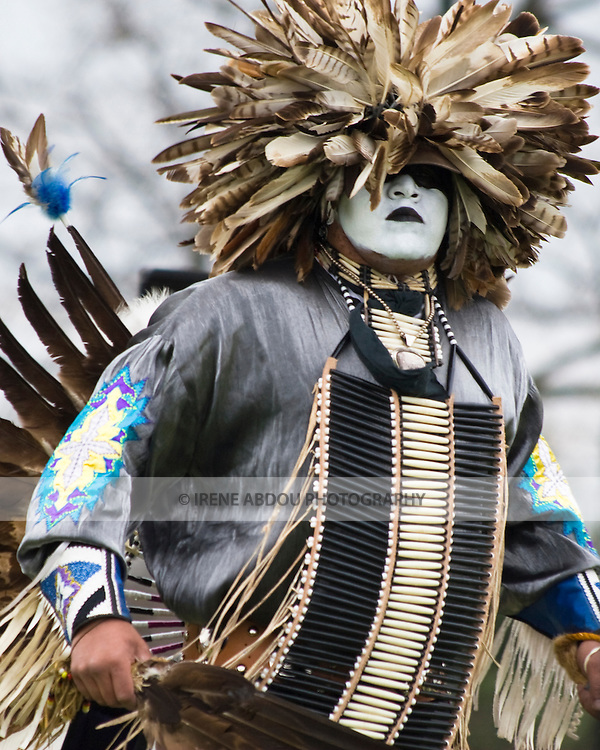 """Charles Hankinson (Eagle Tail), a Native American from the Micmac tribe of Canada, dances in full traditional regalia at the Healing Horse Spirit PowWow. His face paint was """"gifted"""" to him by his grandfather."""