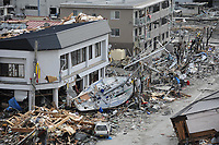 A fishing boat is noticeably out of place after being swept ashore during a massive tsunami that impacted this Japanese fishing port. The town was devastated by an 8.9-magnitude earthquake that triggered the destructive tsunami, which ravaged Japan's eastern seaboard. Teams from the United States, United Kingdom and China arrived here to assist in searching for missing residents.