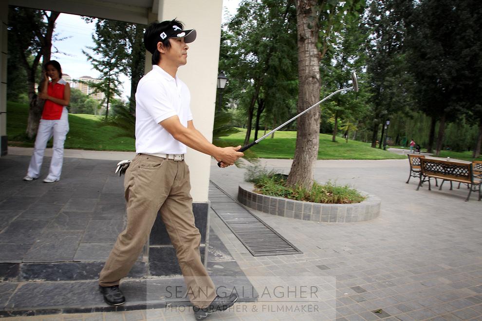 CHINA. A golfer at the Huatang International Golf Club in Beijing. 2009