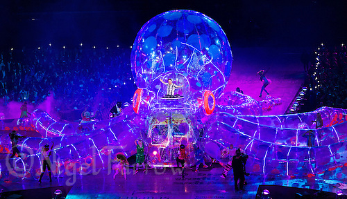 """12 AUG 2012 - LONDON, GBR - Fatboy Slim, aka Norman Cook,  performs from on top of an inflatable octopus during the """"A Symphony of British Music"""" section of the London 2012 Olympic Games Closing Ceremony in the Olympic Stadium in the Olympic Park, Stratford, London, Great Britain (PHOTO (C) 2012 NIGEL FARROW)"""