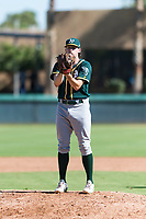 Oakland Athletics relief pitcher Chase Cohen (51) looks in for the sign during an Instructional League game against the Los Angeles Dodgers at Camelback Ranch on September 27, 2018 in Glendale, Arizona. (Zachary Lucy/Four Seam Images)