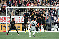 FOXBOROUGH, MA - AUGUST 3: The defensive wall leaps to deflect a Carles Gil #22 of New England Revolution goal during a game between Los Angeles FC and New England Revolution at Gillette Stadium on August 3, 2019 in Foxborough, Massachusetts.