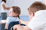 USA, Illinois, Metamora, Teacher and students (8-9) in classroom, boy bullying girl