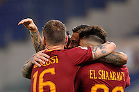 Calcio, Serie A: Roma vs Palermo. Roma, stadio Olimpico, 23 ottobre 2016.<br /> Roma's Leandro Paredes, center, celebrates with teammates Daniele De Rossi, left, and Stephan El Shaarawy after scoring during the Italian Serie A football match between Roma and Palermo at Rome's Olympic stadium, 23 October 2016. Roma won 4-1.<br /> UPDATE IMAGES PRESS/Riccardo De Luca