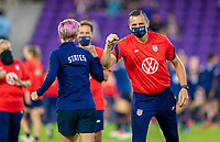 ORLANDO, FL - FEBRUARY 24: Megan Rapinoe #15 is welcomed to the field by Vlatko Andonovski of the USWNT before a game between Argentina and USWNT at Exploria Stadium on February 24, 2021 in Orlando, Florida.