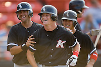 Gordon Beckham (center) of the Kannapolis Intimidators and teammates Christian Marrero (left) and Matt Inouye (right) are all smiles following Beckham's 3-run home run in the 5th inning at L.P. Frans Stadium in Hickory, NC, Sunday August 17, 2008. (Photo by Brian Westerholt / Four Seam Images)