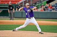 Starting pitcher B.J. Nobles (18) of Western Carolina delivers a pitch against Mercer in the final game of the SoCon Tournament championship series on Sunday, May 29, 2016, at Fluor Field at the West End in Greenville, South Carolina. Western won, 3-2. (Tom Priddy/Four Seam Images)