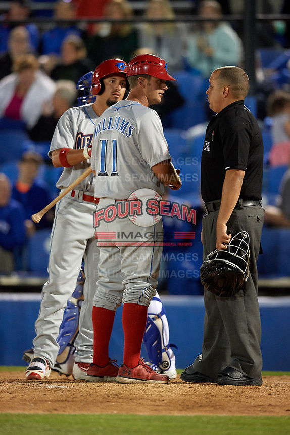 Clearwater Threshers manager Shawn Williams (11) and Herlis Rodriguez (27) argue a call with umpire J.C. Velez during a game against the Dunedin Blue Jays on April 8, 2017 at Florida Auto Exchange Stadium in Dunedin, Florida.  Dunedin defeated Clearwater 12-6.  (Mike Janes/Four Seam Images)