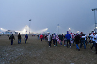 USA fans march from a tailgate to enter Dick's Sporting Good Park in Commerce City, CO before the USA Men's National Team's World Cup Qualifier against Costa Rica on March 22, 2013.