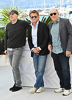 CANNES, FRANCE. July 11, 2021: Fernando Sulichin, Sean Penn & William Horberg at the photocall for Flag Day at the 74th Festival de Cannes.<br /> Picture: Paul Smith / Featureflash