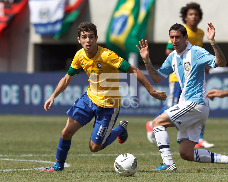 Brazil midfielder Oscar (10) at midfield looks to pass. In an international friendly (Clash of Titans), Argentina defeated Brazil, 4-3, at MetLife Stadium on June 9, 2012.