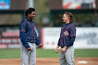 Cedar Rapids Kernels Yeltsin Encarnacion (43) and Hunter Lee (1) talk between innings of a Midwest League game against the Kane County Cougars at Northwestern Medicine Field on April 28, 2019 in Geneva, Illinois. Kane County defeated Cedar Rapids 3-2 in game one of a doubleheader. (Zachary Lucy/Four Seam Images)
