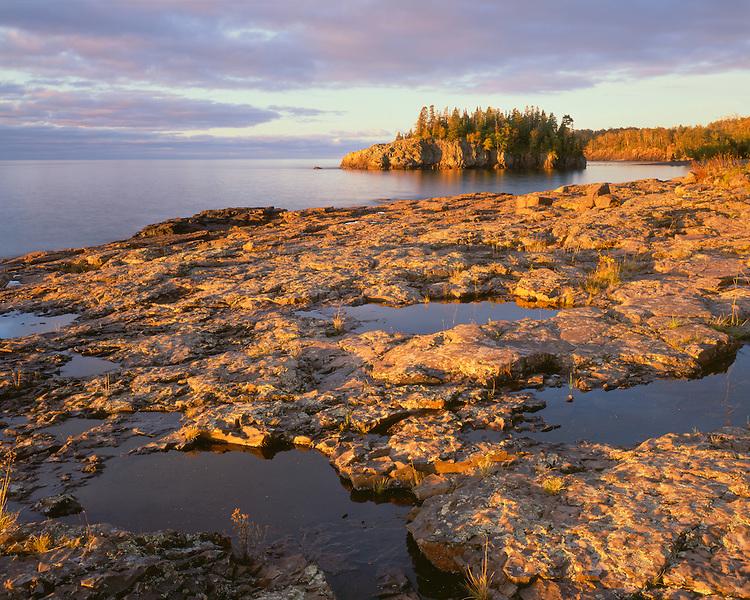 Sunrise light on the shore of Lake Superior; Splitrock Lighthouse State Park, MN