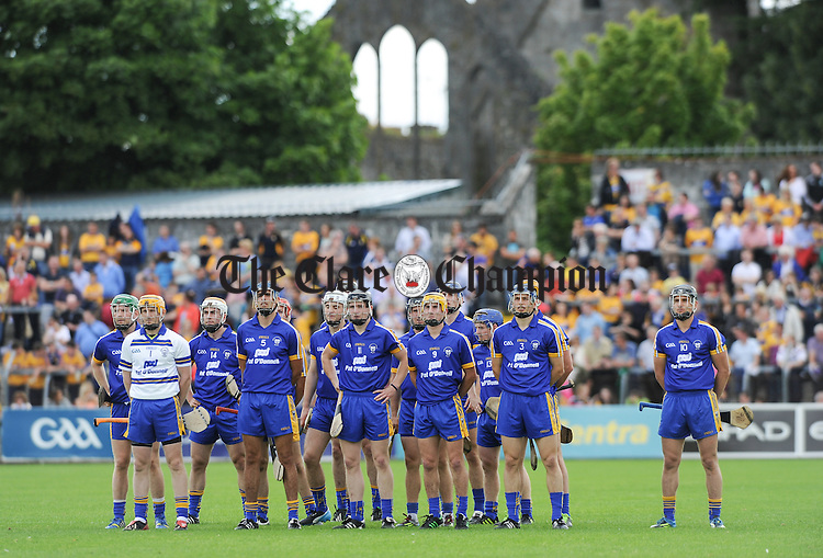 The Clare team stand for the anthem before their All-Ireland qualifier game against Wexford at Cusack Park. Photograph by John Kelly.