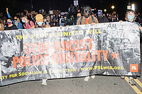 """A group of at least 1000 people marched in Boston, Massachusetts, on Fri., Sept. 25, 2020, to demand justice for the police killing of Breonna Taylor after this week's announcement that the Louisville, Kentucky, police officers would not be charged. The group marched from Nubian Square in Roxbury to the Boston Police Department Headquarters and then to downtown Boston. The killing of Breonna Taylor, along with the killing of other people of color by police in 2020 and previously, has led to widespread protest and demonstration throughout the country. This week's decision not to charge the officers in her killing has led to a recharged protest movement in Boston and elsewhere. <br /> The sign here reads """"Stop racist police brutality."""""""