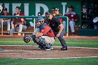 Chase Vallot (44) of the Idaho Falls Chukars on defense as umpire Rene Gallagos handles the calls behind the plate during a game between the Ogden Raptors and the Idaho Falls Chukars at Lindquist Field on August 29, 2018 in Ogden, Utah. Idaho Falls defeated Ogden 15-6. (Stephen Smith/Four Seam Images)