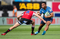 March 14th 2020, Eden Park, Auckland, New Zealand;  Blues centre TJ Faiane tries to avoid the tackle against the Lions during the Super Rugby match between the Blues and the Lions, held at Eden Park, Auckland, New Zealand.