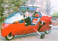 BNPS.co.uk (01202) 558833. <br /> Pic: Rowley's/DeepSouth/BNPS<br /> <br /> Pictured: Ecomobile inventor Arnold Wagner pictured in the machine which has now sold. <br /> <br /> A rare Ecomobile designed by a madcap inventor that left Jeremy Clarkson speechless has sold for over £11,000.<br /> <br /> The 1995 Peraves Super Turbo was 12ft long, 4ft wide and essentially an enclosed motorcycle, but the driver had to put down its stabilisers every time the machine came to rest.<br /> <br /> Only 89 of the bizarre contraptions were ever made before the concept was scrapped, but not before it was tested on Jeremy Clarkson's Motorworld in 1996.