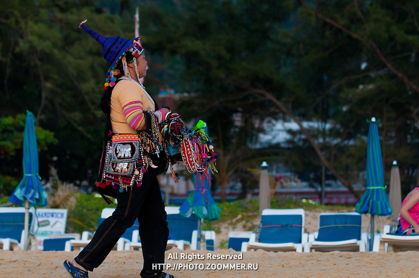 Thai woman selling staff on Phuket beach, Thailand