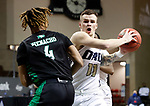 SIOUX FALLS, SD - MARCH 7: Carlos Jurgens #11 of the Oral Roberts Golden Eagles drives to the basket against Tyree Ihenacho #4 of the North Dakota Fighting Hawks during the Summit League Basketball Tournament at the Sanford Pentagon in Sioux Falls, SD. (Photo by Richard Carlson/Inertia)