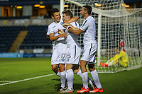 Dayle Southwell of Wycombe Wanderers (centre) celebrates scoring his team's first goal against Brentford to make it 1-1  during the Friendly match between Wycombe Wanderers and Brentford at Adams Park, High Wycombe, England on 19 July 2016. Photo by David Horn PRiME Media Images.