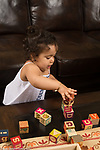 19 month old toddler girl building block tower