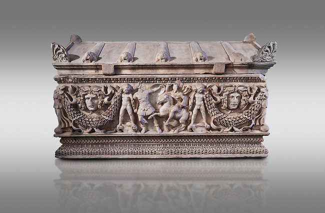 Side panel of a Roman relief garland  sculpted sarcophagus, style typical of Pamphylia, 3rd Century AD, Konya Archaeological Museum, Turkey. Against a grey background